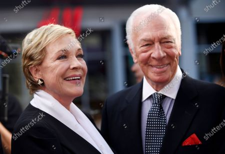 """Stock Image of Julie Andrews, left, and Christopher Plummer, cast members in the classic film """"The Sound of Music,"""" pose together before a 50th anniversary screening of the film on the opening night of the TCM Classic Film Festival, in Los Angeles. Plummer, the dashing award-winning actor who played Captain von Trapp in the film """"The Sound of Music"""" and at 82 became the oldest Academy Award winner in history, has died. He was 91. Plummer died Friday morning, Feb. 5, 2021, at his home in Connecticut with his wife, Elaine Taylor, by his side, said Lou Pitt, his longtime friend and manager"""