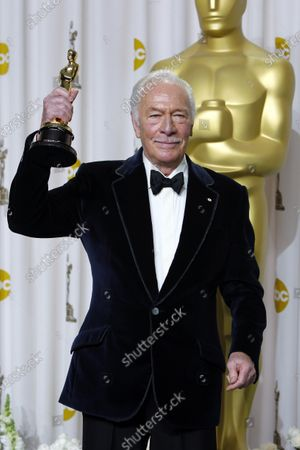 """Christopher Plummer poses with the Oscar for best supporting actor for his work in """"Beginners"""" during the 84th Academy Awards, in the Hollywood section of Los Angeles. Plummer, the dashing award-winning actor who played Captain von Trapp in the film """"The Sound of Music"""" and at 82 became the oldest Academy Award winner in history, has died. He was 91. Plummer died Friday morning, Feb. 5, 2021, at his home in Connecticut with his wife, Elaine Taylor, by his side, said Lou Pitt, his longtime friend and manager"""