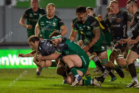 Jamie Roberts  of Dragons is tackled by Tom Daly of Connacht