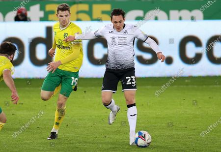Stock Picture of Connor Roberts of Swansea City is challenged by Jacob Lungi S¿rensen of Norwich City.