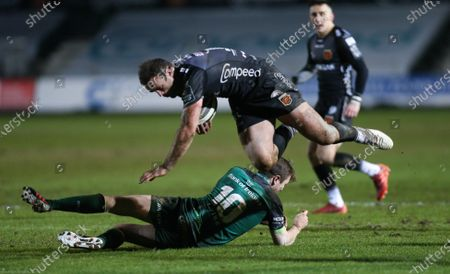 Stock Photo of Jamie Roberts of Dragons is tackled by Jack Carty of Connacht