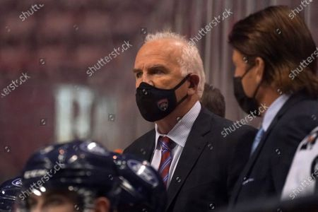 Stock Photo of Florida Panthers head coach Joel Quenneville looks on during the third period of an NHL hockey game against the Nashville Predators, in Sunrise, Fla