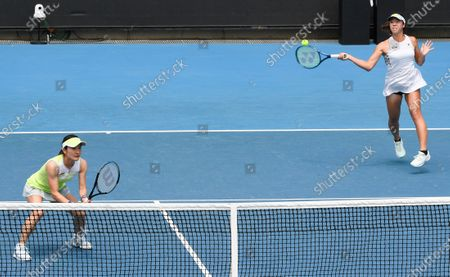 Japan's Shuko Aoyama and Ena Shibahara, right, against Nicole Melichar of the United States and Demi Schuurs of the Netherlands during their doubles match at a tuneup event ahead of the Australian Open tennis championships in Melbourne, Australia
