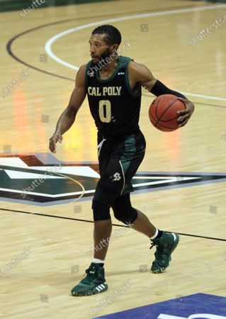 Stock Image of Cal Poly Mustangs guard Keith Smith #0 brings the ball up court during a game between the Hawaii Rainbow Warriors and the Cal Poly Mustangs at SimpliFi Arena at the Stan Sheriff Center in Honolulu, HI - Michael Sullivan/CSM