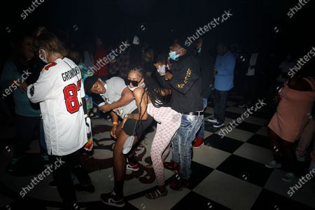 Stock Image of DJ Funkmaster Flex performs while a crowd dances during the Pre-Super Bowl Red Carpet Event & Concert at the Ritz Ybor in Tampa, Florida on Friday, February 6, 2021.