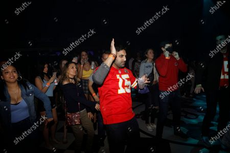 DJ Funkmaster Flex performs while a crowd dances during the Pre-Super Bowl Red Carpet Event & Concert at the Ritz Ybor in Tampa, Florida on Friday, February 6, 2021.