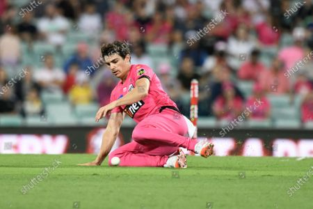 Stock Picture of Sean Abbott of the Sydney Sixers fields the ball; Sydney Cricket Ground, Sydney, New South Wales, Australia; Big Bash League Cricket, Final, Sydney Sixers versus Perth Scorchers.