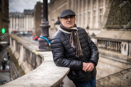 French Algerian Yunice Abbas, 67, poses for photographs for the release of his book  'J'ai sequestre Kim Kardashian' (I held  Kim Kardashian captive) in Paris, France, 05 February 2021 (issued 06 February 2021). Abbas was a member of the group who held at gunpoint US celebrity Kim Kardashian to steal several millions worth of jewelry from her apartment during the Paris Fashion Week in October 2016.