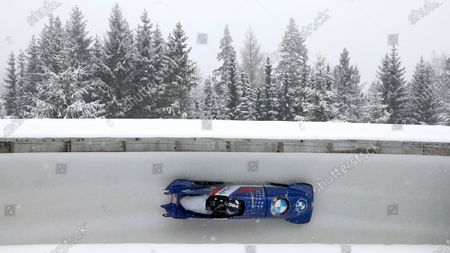 Elana Meyers Taylor and Sylvia Hoffmann of the United States speed down the track during the two women's bobsleigh race at the Bobsleigh and Skeleton World Championships in Altenberg, Germany