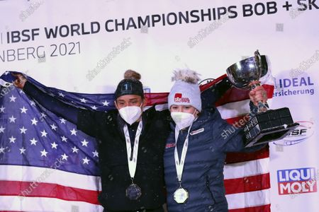 Kaillie Humphries, right, and Lolo Jones of the United States celebrate after winning the two women's bobsleigh race at the Bobsleigh and Skeleton World Championships in Altenberg, Germany