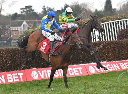 (R) Sporting John (Richard Johnson) takes the last  before going on to win The Virgin Bet Scilly Isles Novices Steeple Chase from (L) Shan Blue (Harry Skelton). Photo © Hugh Routledge.