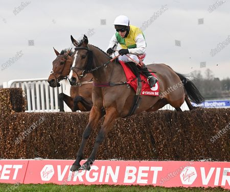 Deise Aba (Richard Johnson) takes the last on the first circuit before going on to win The Virgin Bet Masters Handicap Steeple Chase. Photo © Hugh Routledge.