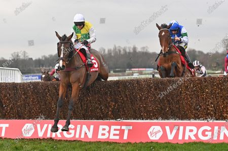 (L) Deise Aba (Richard Johnson) takes the last before going on to win The Virgin Bet Masters Handicap Steeple Chase from (R) Coo Star Sivola (Sam Twiston-Davies). Photo © Hugh Routledge.