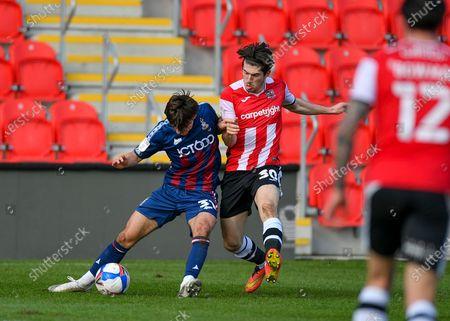 Bradford City midfielder Oliver Crankshaw (31)  shields the ball  during the EFL Sky Bet League 2 match between Exeter City and Bradford City at St James' Park, Exeter