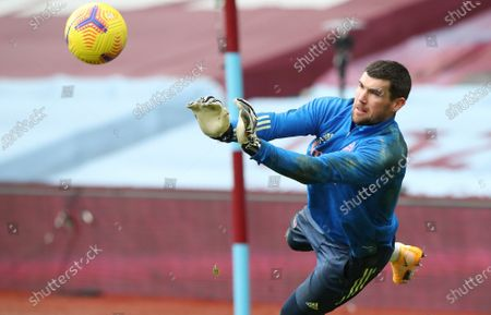 Arsenal's goalkeeper Mathew Ryan warms up prior to the start of the English Premier League soccer match between Aston Villa and Arsenal at Villa Park in Birmingham, England