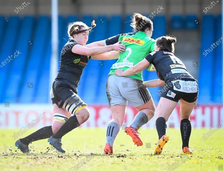 Lauren Cattell and Ebony Jefferies of Exeter Chiefs attempt a tackle on Amy Cokayne of Harlequins