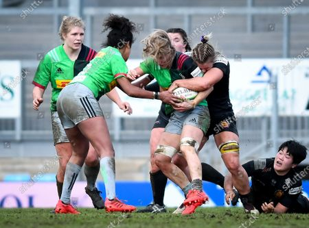 Rachel Johnson of Exeter Chiefs attempts a tackle on Bethan Dainton of Harlequins