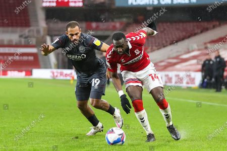 Stock Picture of Middlesbrough midfielder Yannick Bolasie (14) and Brendford midfielder Bryan Mbeumo (19) during the EFL Sky Bet Championship match between Middlesbrough and Brentford at the Riverside Stadium, Middlesbrough