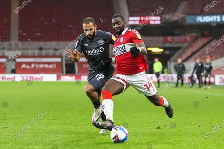 Middlesbrough midfielder Yannick Bolasie (14) and Brendford midfielder Bryan Mbeumo (19) during the EFL Sky Bet Championship match between Middlesbrough and Brentford at the Riverside Stadium, Middlesbrough