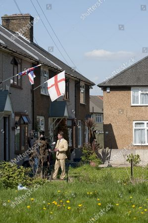 Stock Photo of Councillor Richard Barnbrook (suit) British National Party, Deputy Leader of the British National Party Minority Group, on a Barking and Dagenham council estate being interviewed