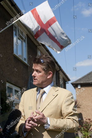 Councillor Richard Barnbrook (suit) British National Party, Deputy Leader of the British National Party Minority Group, on a Barking and Dagenham council estate being interviewed