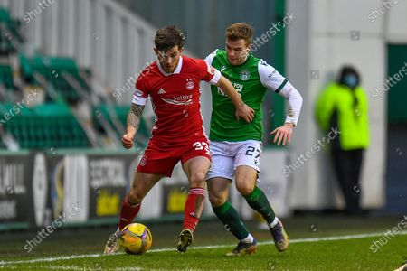 Matty Kennedy (#33) of Aberdeen FC shields the ball from Chris Cadden (#27) of Hibernian FC during the SPFL Premiership match between Hibernian and Aberdeen at Easter Road Stadium, Edinburgh