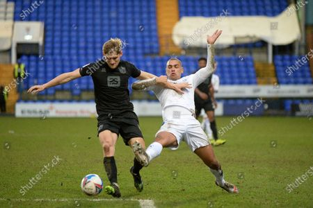 Tranmere Rovers striker James Vaughan (9) challenges Port Vale defender Nathan Smith (6) during the EFL Sky Bet League 2 match between Tranmere Rovers and Port Vale at Prenton Park, Birkenhead