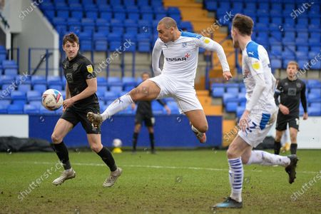 Tranmere Rovers striker James Vaughan (9) shoots and misses during the EFL Sky Bet League 2 match between Tranmere Rovers and Port Vale at Prenton Park, Birkenhead