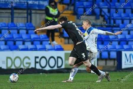 Tranmere Rovers striker James Vaughan (9) challenges Port Vale defender Adam Crookes (3) during the EFL Sky Bet League 2 match between Tranmere Rovers and Port Vale at Prenton Park, Birkenhead