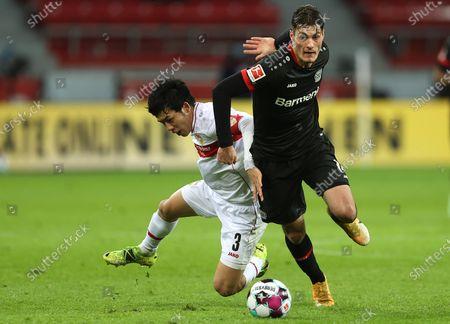 Wataru Endo of VfB Stuttgart (L) battles for possession with Patrik Schick of Bayer 04 Leverkusen during the Bundesliga match between Bayer 04 Leverkusen and VfB Stuttgart at BayArena in Leverkusen, Germany, 06 Feburary 2021.
