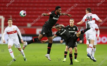 Timothy Fosu-Mensah and Charles Aranguiz of Bayer Leverkusen compete for a header with Philipp Foerster of VfB Stuttgart (R) during the Bundesliga match between Bayer 04 Leverkusen and VfB Stuttgart at BayArena in Leverkusen, Germany, 06 Feburary 2021.