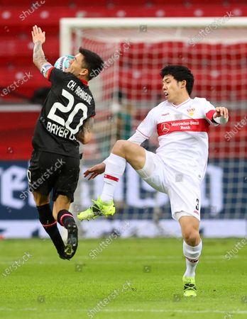 Charles Aranguiz of Bayer 04 Leverkusen is challenged by Wataru Endo of VfB Stuttgart during the Bundesliga match between Bayer 04 Leverkusen and VfB Stuttgart at BayArena in Leverkusen, Germany, 06 Feburary 2021.