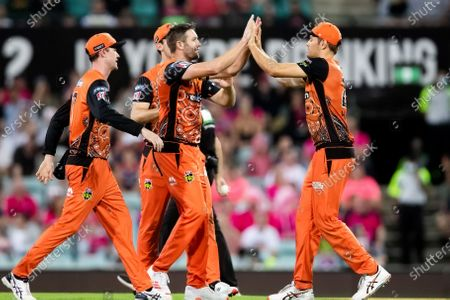 Perth Scorchers player Andrew Tye celebrates taking the wicket of Sydney Sixers player Moises Henriques during the Big Bash League final cricket match between Sydney Sixers and Perth Scorchers.