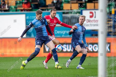 Josh Knight of Wycombe Wanderers (L) Glenn Murray of Nottingham Forest (centre) and Jack Grimmer of Wycombe Wanderers