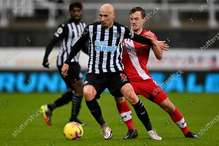 Newcastle's Jonjo Shelvey holds back Southampton's James Ward-Prowse during the English Premier League soccer match between Newcastle United and Southampton, at St. James' Park Stadium in Newcastle, England