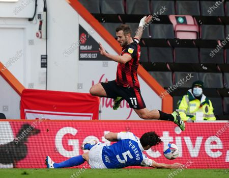 Jack Wilshere of Bournemouth leaps over George Friend of Birmingham City.