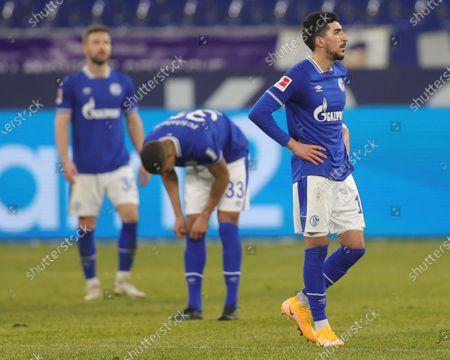 (L-R) Schalke's Shkodran Mustafi, William de Asevedo Furtado and Nassim Boujellab react after Leipzig's second goal during the German Bundesliga soccer match between FC Schalke 04 and RB Leipzig in Gelsenkirchen, Germany, 06 February 2021.