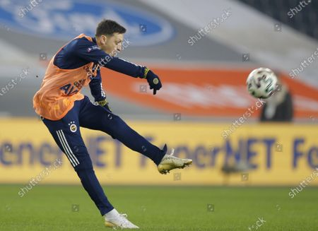 Mesut Oezil of Fenerbahce warms up at the half time of the Turkish Super League soccer match between Fenerbahce and Galatasaray in Istanbul, Turkey, 06 February 2021.