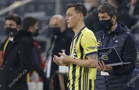 Mesut Oezil of Fenerbahce prays as he enter the pitch during the Turkish Super League soccer match between Fenerbahce and Galatasaray in Istanbul, Turkey, 06 February 2021.