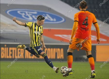 Mesut Oezil (L) of Fenerbahce in aciton against Taylan Antalyali (R) of Galatasaray during  the Turkish Super League soccer match between Fenerbahce and Galatasaray in Istanbul, Turkey, 06 February 2021.