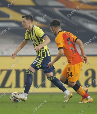 Stock Image of Mesut Oezil (L) of Fenerbahce in action against Emre Kilinc (R) of Galatasaray during the Turkish Super League soccer match between Fenerbahce and Galatasaray in Istanbul, Turkey, 06 February 2021.