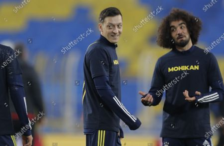 Mesut Oezil (L) of Fenerbahce warms up for the Turkish Super League soccer match between Fenerbahce and Galatasaray in Istanbul, Turkey, 06 February 2021.