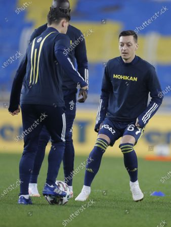Mesut Oezil (R) of Fenerbahce warms up for the Turkish Super League soccer match between Fenerbahce and Galatasaray in Istanbul, Turkey, 06 February 2021.