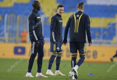 Mesut Oezil (C) of Fenerbahce warms up for the Turkish Super League soccer match between Fenerbahce and Galatasaray in Istanbul, Turkey, 06 February 2021.