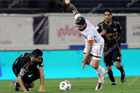 Al-Shabab's player Ever Banega (C) in action against Al-Raed's Abdullah Al-Mogren (L) during the Saudi Professional League soccer match between Al-Shabab and Al-Raed at Al-Shabab Club Stadium, Riyadh, Saudi Arabia, 06 February 2021.