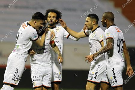 Al-Shabab's player Ever Banega (2-L) celebrates with teammates after scoring a goal during the Saudi Professional League soccer match between Al-Shabab and Al-Raed at Al-Shabab Club Stadium, Riyadh, Saudi Arabia, 06 February 2021.