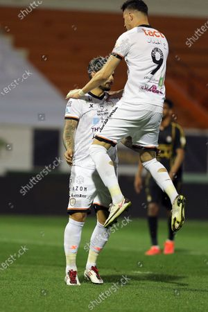 Al-Shabab's player Ever Banega (L) celebrates with teammate after scoring a goal during the Saudi Professional League soccer match between Al-Shabab and Al-Raed at Al-Shabab Club Stadium, Riyadh, Saudi Arabia, 06 February 2021.