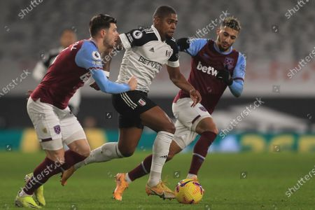 Fulham's Ivan Cavaleiro, center, is challenged by West Ham's Said Banrahma, right and West Ham's Aaron Cresswell during the English Premier League match between Fulham and West Ham at the Craven Cottage stadium in London