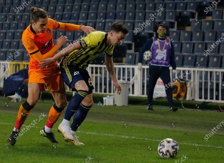 Fenerbahce's Mesut Ozil, right, of Germany, dribbles past Galatasaray's Martin Linnes, left, during a Turkish Super League soccer match between Fenerbahce and Galatasaray in Istanbul, . Ozil, who is of Turkish descent and was formerly with Arsenal came in as a substitute on his his first match with Fenerbahce. Galatasaray won the match 1-0
