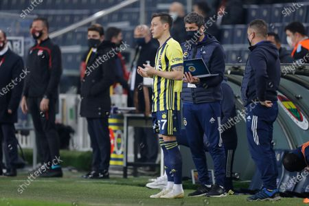 Fenerbahce's Mesut Ozil, of Germany, prays before entering the pitch as a substitute player during a Turkish Super League soccer match between Fenerbahce and Galatasaray in Istanbul, . Ozil, who is of Turkish descent and was formerly with Arsenal came in as a substitute on his first match with Fenerbahce. Galatasaray won the match 1-0